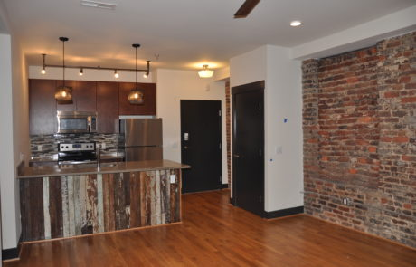 Main living area showing the kitchen in a loft apartment at Factory 88 downtown, Lynchburg Virginia